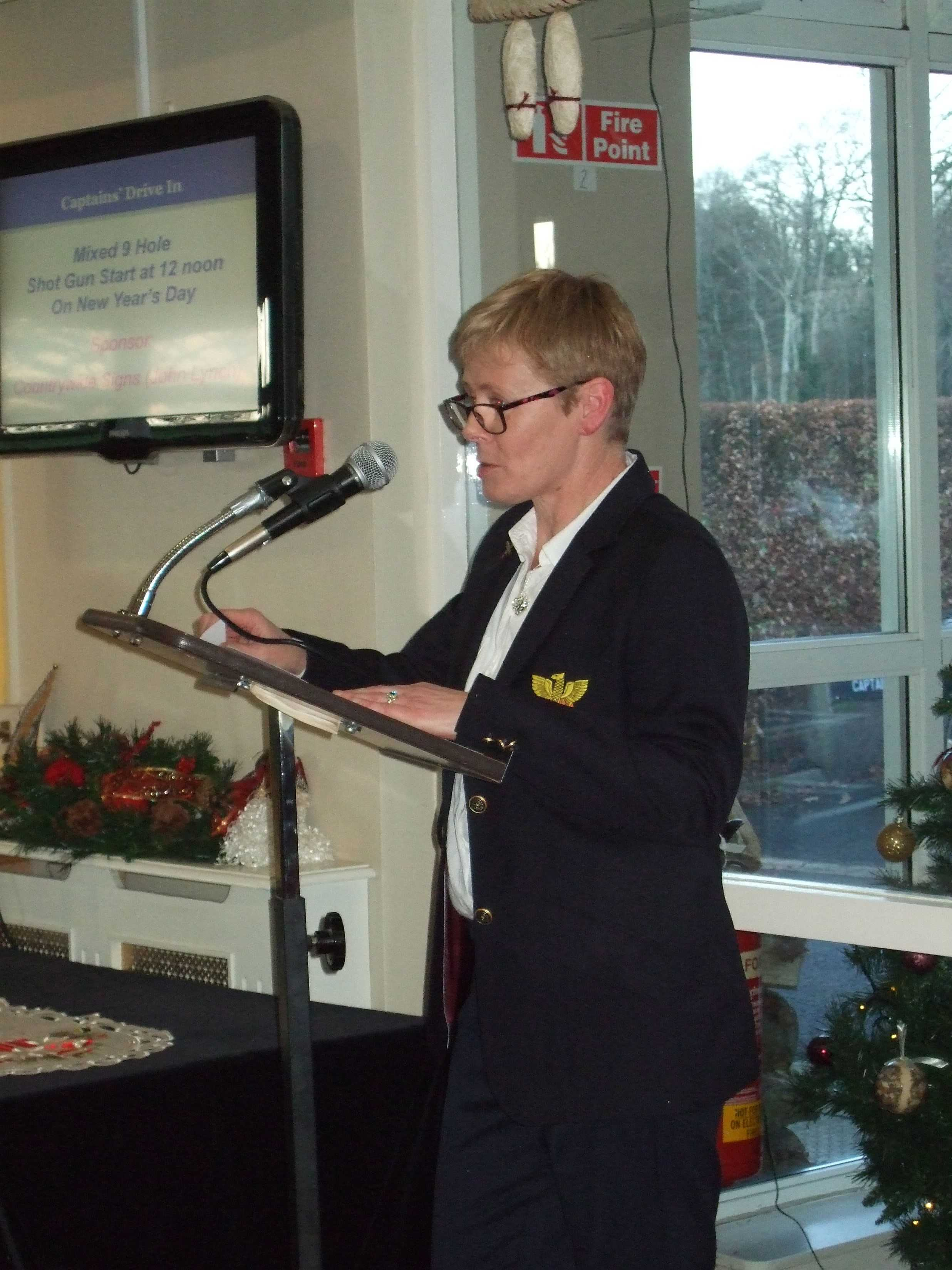 Lady Captain Stephanie at the Podium