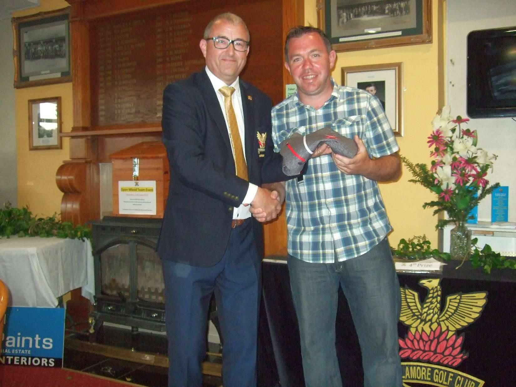 Colm Cassidy 3rd in Bernard Quigley's prize receives it from Captain Brian Gunning