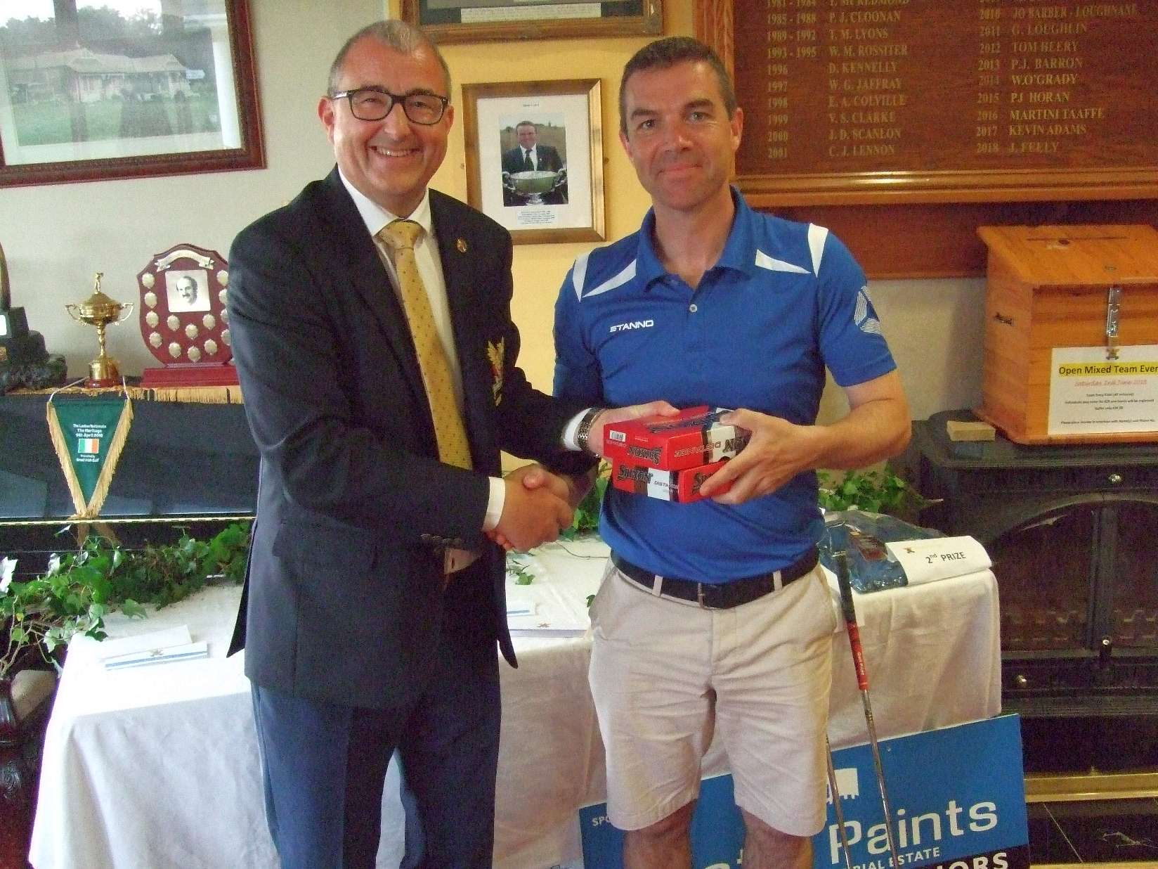 Declan Farrell receives his prize from Captain Brian for the Castle Paints sponsored Fourball