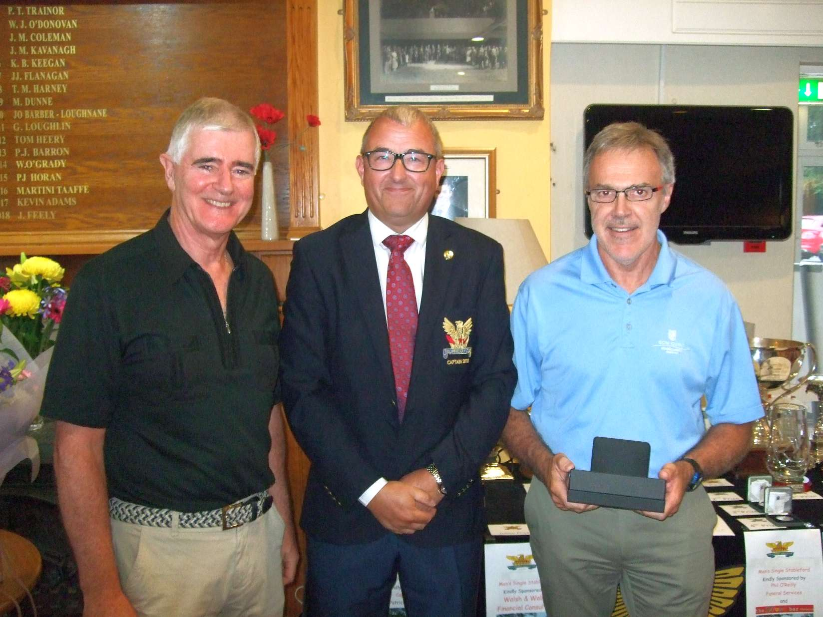 Leonard O Keeffe winner of the Walsh & Walsh Financial Consulting prize with Tom Walsh and Captain Brian Gunning
