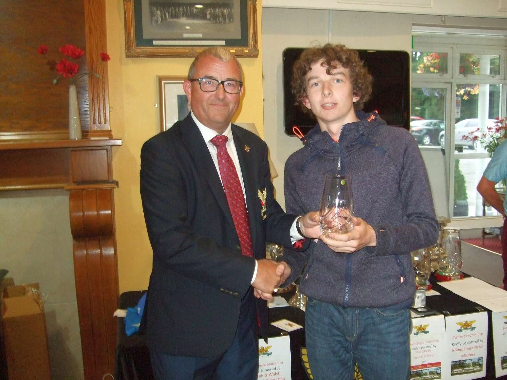 Liam Delaney  1st nett in the Bridge House sponsored Junior Scratch Cup with Captain Brian Gunning.