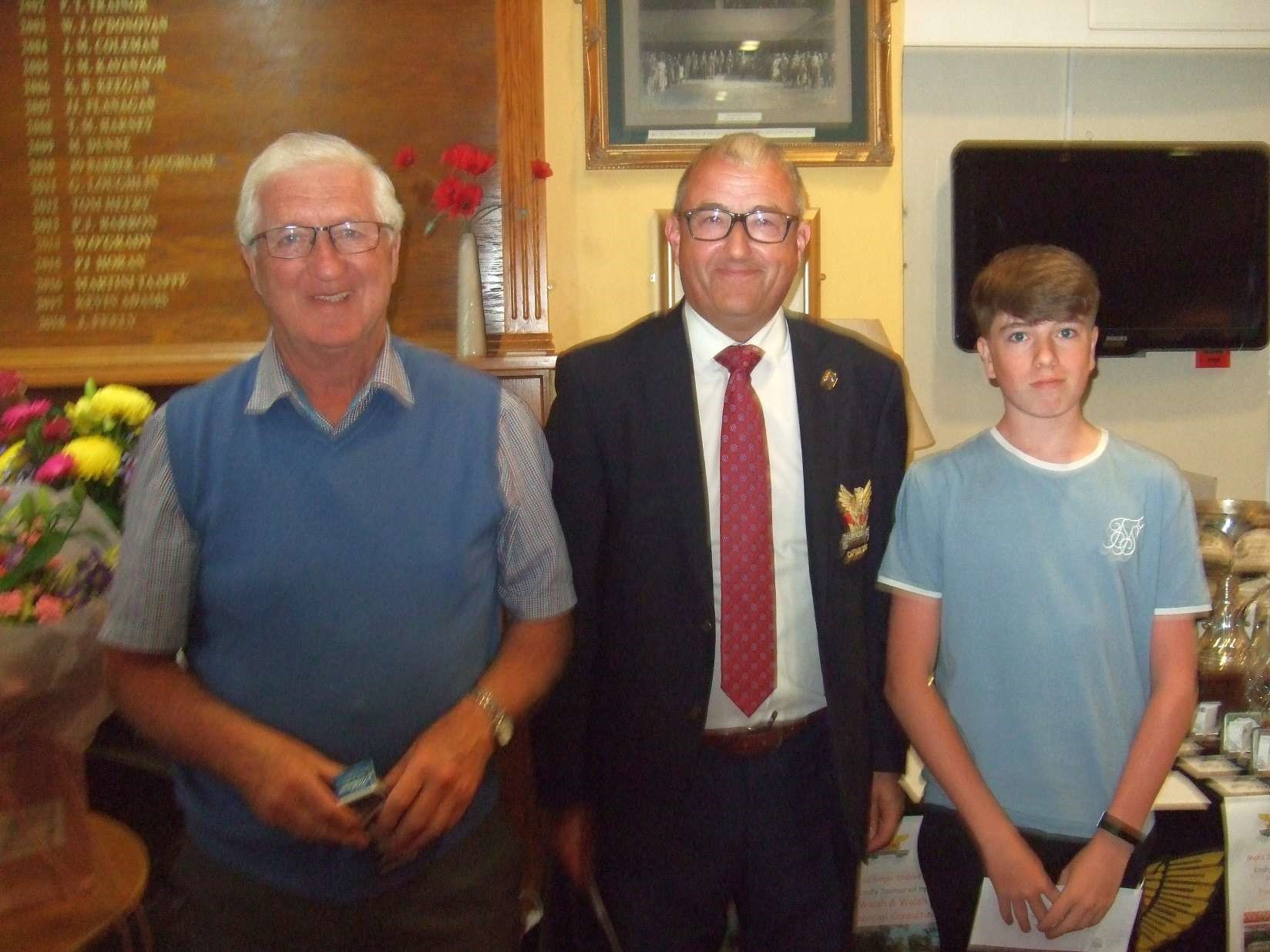 Rory Spollen with Mick Dalton receiving their prize in the Paul Burke Cup from Captain Brian Gunning