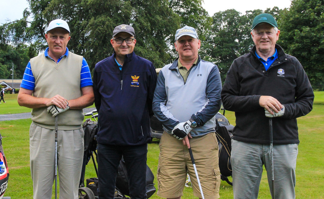 First off in 9-hole Ray Spain Richard Cowman Sean Aherne with Captain Brian