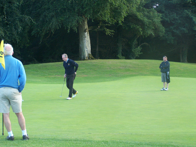 Kevin Troy and his caddy Noel Mannion on the 14th