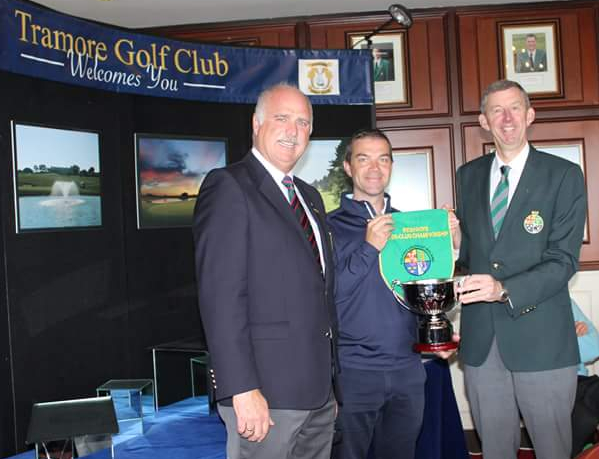 Declan Farrell receives the Green Pennant from Jim Long Chairman of Munster Golf representing the President of the GUI
