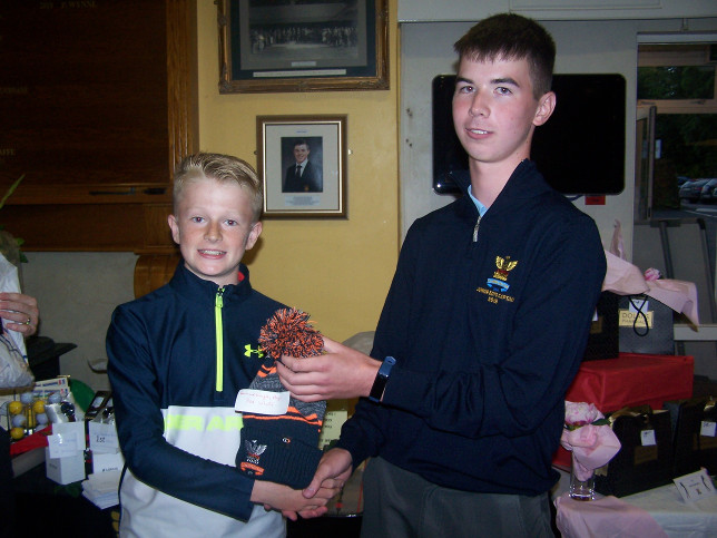 Martin receiving his prize from Boys Captain Colm