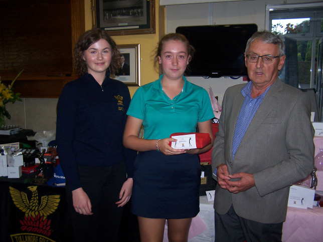 Joanne receiving her prize from Girls captain Leah